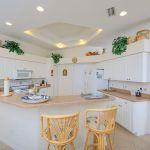 Ferienhaus Florida FVE46175 Küchentheke mit Stühlen