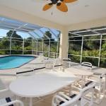 Florida Ferienhaus FVE41712 Terrasse mit Esstisch