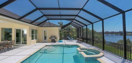 Deluxe-Villa Manasota Beach 42031 mit beheizbarem Pool & Whirlpool und herrlichem Blick auf die Bay in Strandnähe (ca. 800m), Grundstück ca. 1.500 qm, Wohnfläche ca. 250qm, Wechseltag flexibel – Mindestmietzeit 1 Woche.