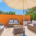 Ferienhaus Pollensa MA2291 Sitzecke mit Sonnenschirm
