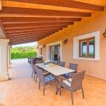 Ferienhaus Mallorca MA4770 überdachte Terrasse mit Esstisch