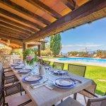 Villa Toskana am Meer TOH790 überdachte Terrasse mit Esstisch